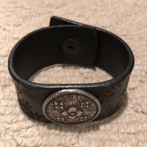 Jewelry - Leather cuff bracelet with silver floral center.